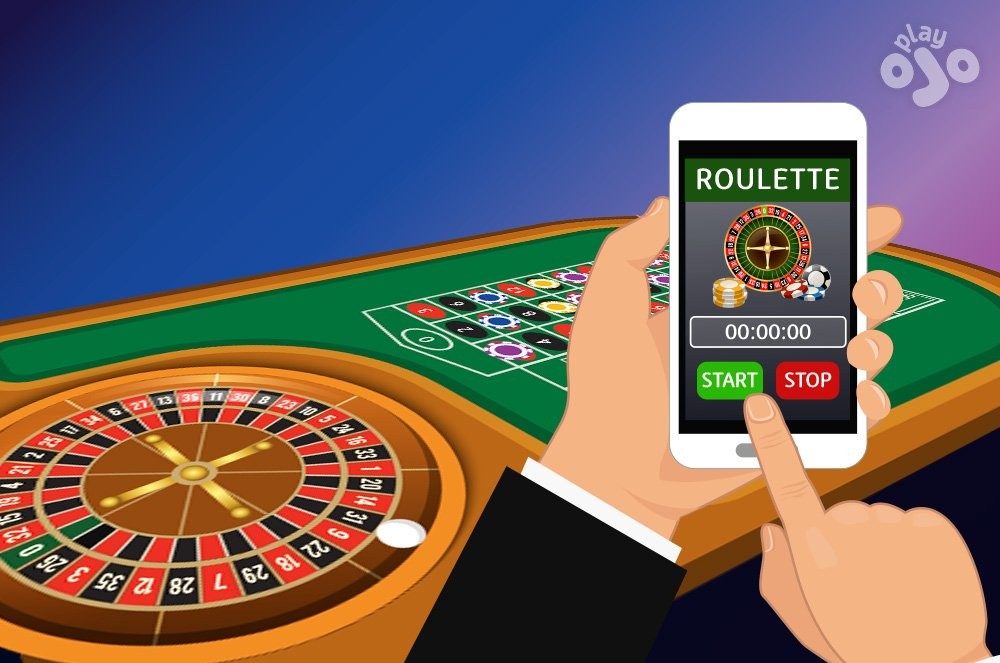 Player stands near wheel and hold mobile phone with a clock app on-screen